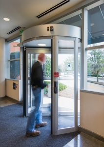 Men walking through revolving door in Burlington, London, Ottawa By Horton Automatics of Ontario